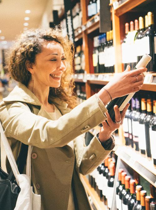 woman buying wine